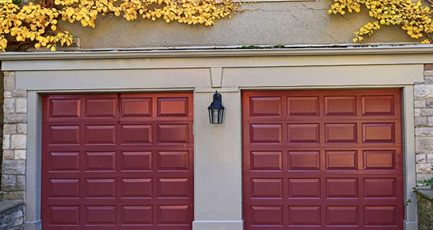 Dark red garage door colors on stone house.
