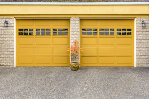 Yellow garage door colors on light brick house.