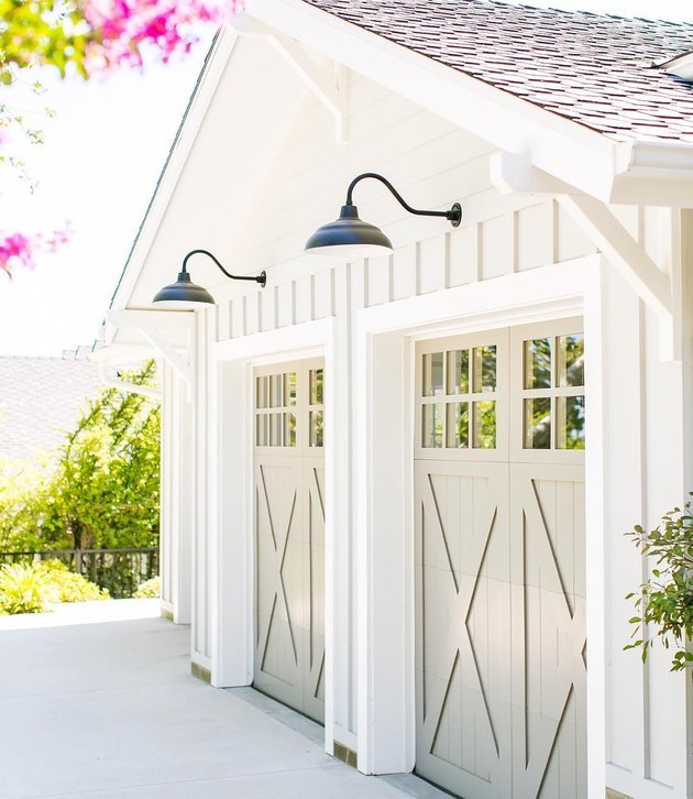 Light gray garage door colors with dock lights.
