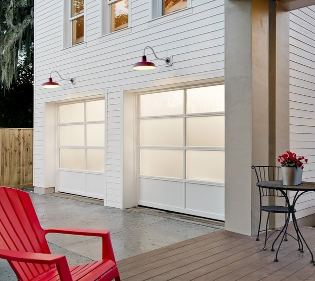 white garage door colors on white contemporary house with red chair.