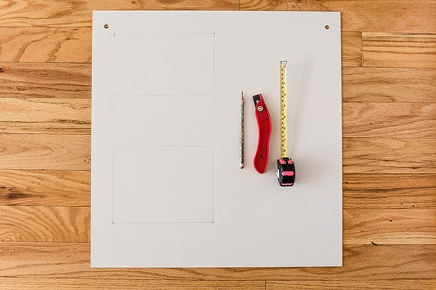 Measure, mark, and cut out any necessary holes for cables and outlets.