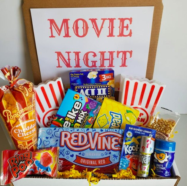 Box full of candy and treats for a movie night