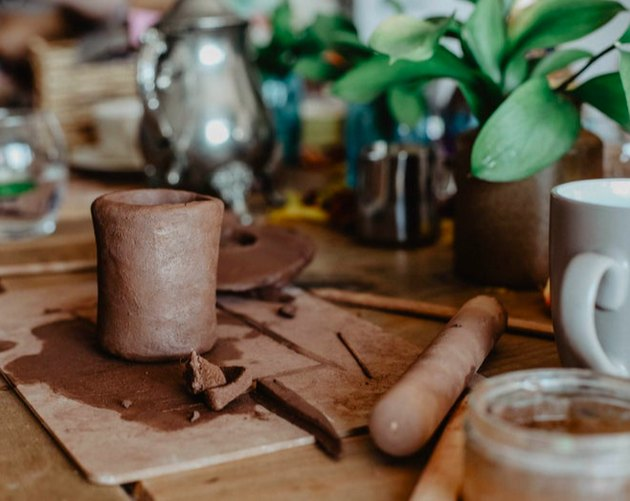 Pottery plants and mugs on a table