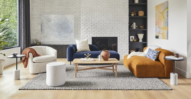 living room with white walls and furniture in different colors