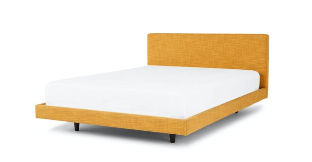 yellow bed frame with white mattress