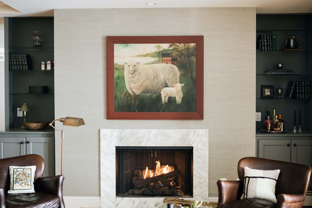 Stone contemporary fireplace mantel and grasscloth wallpaper by Prospect Refuge Studio