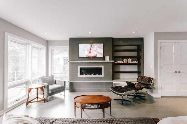 contemporary fireplace mantel with a concrete mantel by Anne McDonald Design
