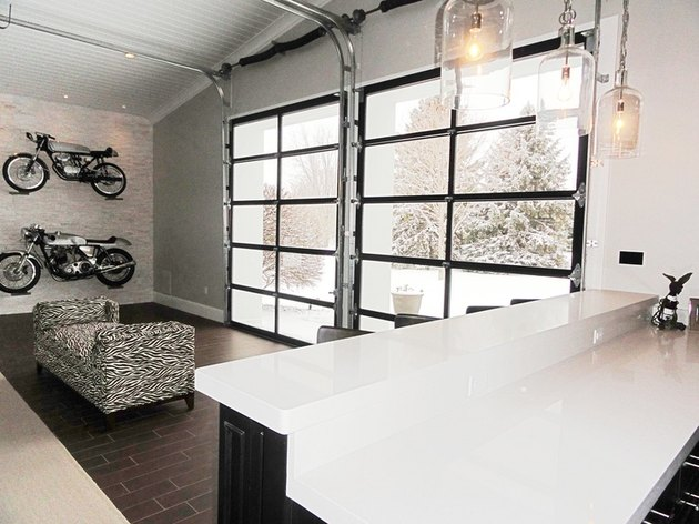 Garage bar ideas with glass garage doors and motorcycles on the wall