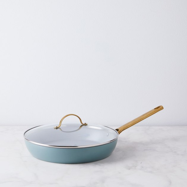 Blue ceramic nonstick cookware pan with brass handle and lid
