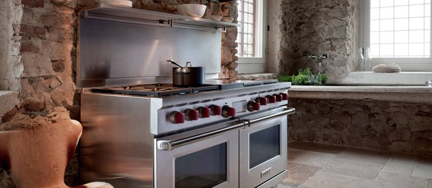 brick kitchen with wolf stove