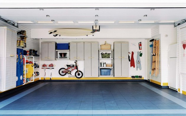 Organized, clean garage with floating shelves and cabinets with Garage Wall Shelving Ideas