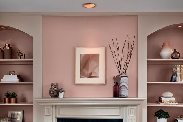 pink wall above fireplace