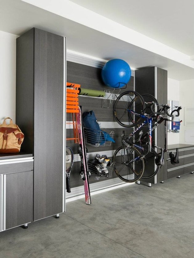 Organized garage storage with cabinets and hooks with Garage Wall Shelving Ideas