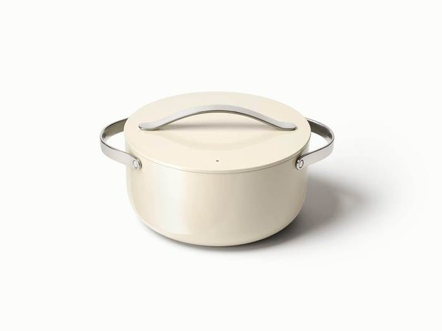 White ceramic nonstick cookware Dutch oven with silver handles on white background