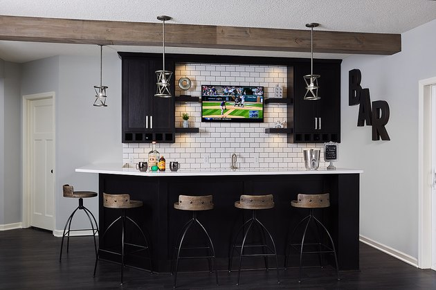 garage bar ideas with white subway tile and barstools