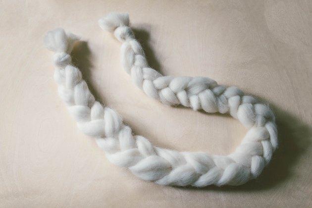 Braided strand of ivory wool