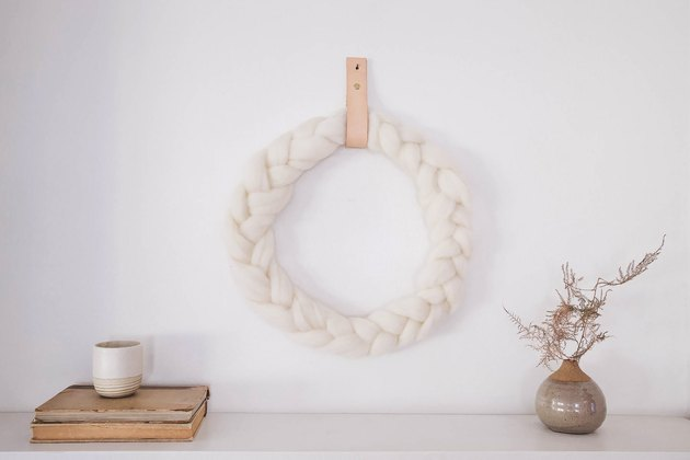 Braided wool wreath with leather hanger