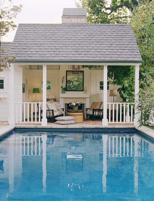 Seating and Fireplace in Covered Porch by Pool