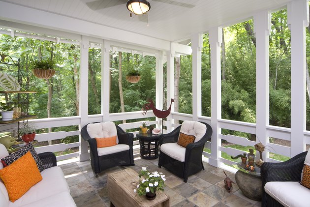 Peaceful enclosed back deck/porch with furniture
