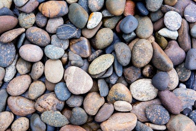 Pebbles background.Gravel background.Colorful pebbles background