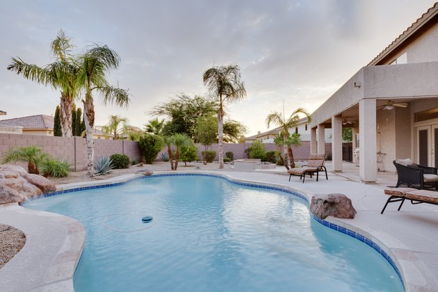 A backyard with pool at a desert home