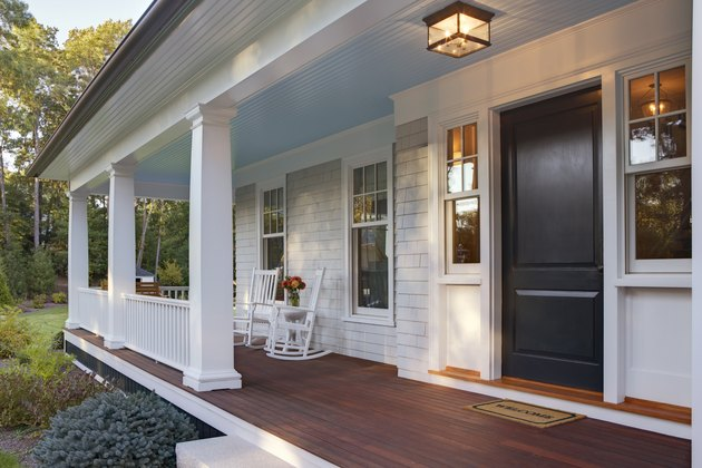 Front porch of new custom home with sun light.