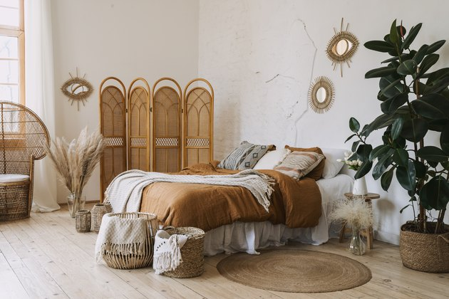 Comfort apartment in bohemian style interior with hygge bedroom
