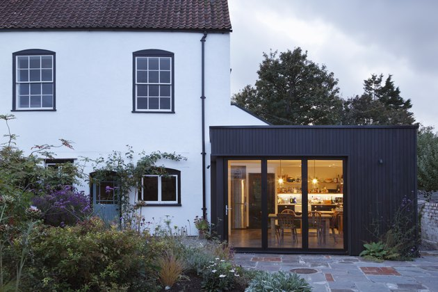 Modern extension built onto the side of a listed period property.