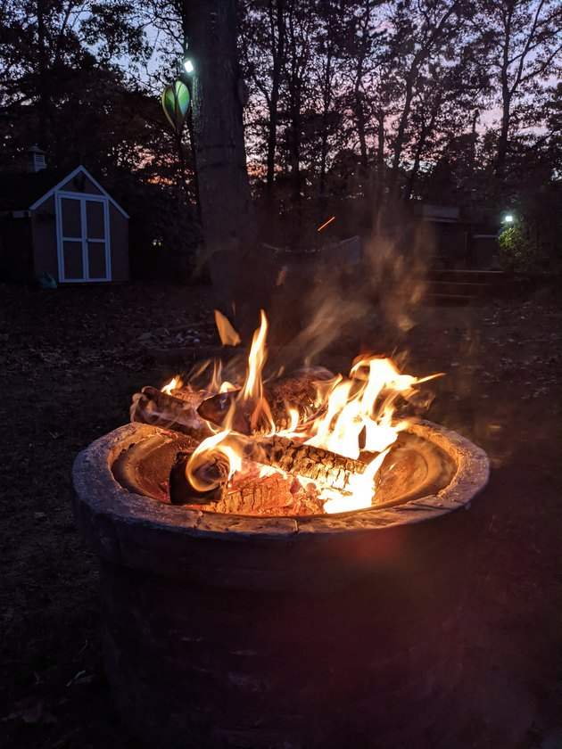 Outdoor fire pit with blazing flames