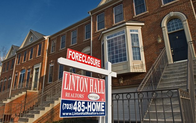A recently foreclosed townhouse is seen