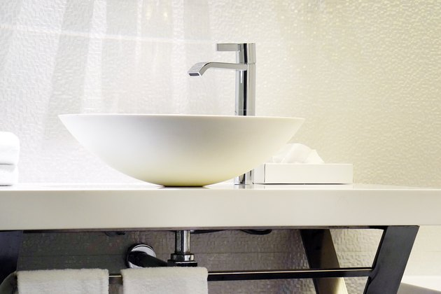Modern white bathroom sink with faucet