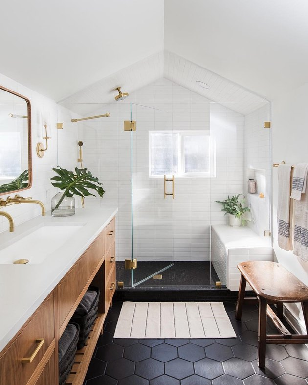 Black and white bathroom with green and gold