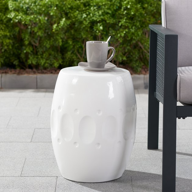 "Classic lovers will beat a path to the Better Homes & Gardens 17"" Pebble Path Ceramic Garden Stool. This crisp white stool holds its own as an elegant accent by a favorite indoor reading chair or outside on the patio, in the garden, or by a poolside chaise lounge."