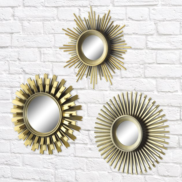 Introduce a sophisticated flair to your living space with this upscale Better Homes and Gardens 3-Piece Round Sunburst Mirror Set in Gold Finish. Each sunburst mirror is different and has a distinct Mid Century Modern flair. Arrange them together on a wall in a small space or above a plant for an artistic design.