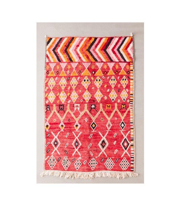 Sourced straight from Morocco by our Urban Renewal team, this one-of-a-kind rug features a wool weave and colorful mixed geometric pattern. Cushy, high pile rug complete with raw, fringed edges. UO exclusive.
