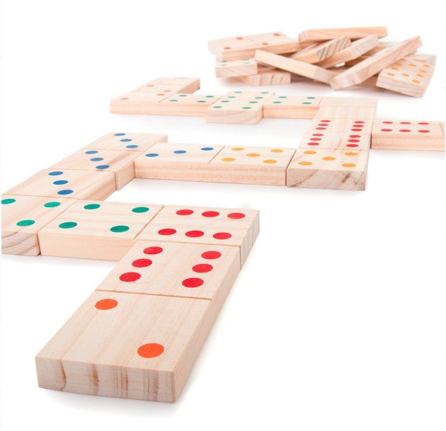 "The Hey! Play! Giant Wooden Dominoes Set takes a classic game to the next level. Set includes 28 tiles measuring 5.38"" x 2.63"" x .63"", offering many variations for game play such as blocking, scoring and draw. Each piece is beautifully hand-crafted out of pine wood, with brightly colored pips on each end. The convenient mesh storage bag makes it easy to bring the fun indoors or outdoors."