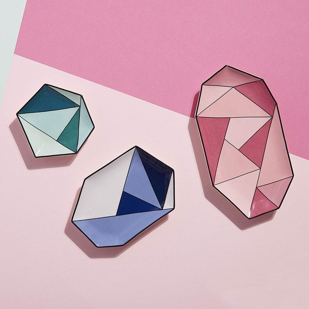 Glazed stoneware trays featuring gem-inspired angles in gradating shades of pink, blue or green. Available in three sizes, these pops of color are meant to mix, match and shine