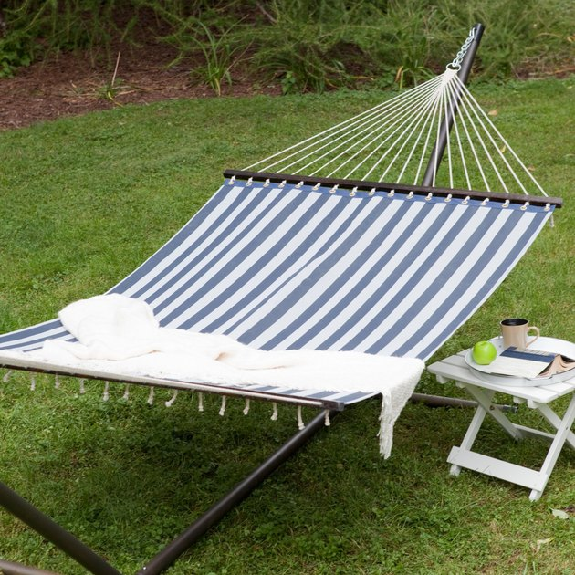 You'll love how its classic nautical look with blue and white stripes brings a whiff of the sea right to your backyard. And when it comes to comfort, this hammock has no equals! Made of weather-resistant, quick dry polyester fabric, this hammock will take relaxation to a whole new level; so much so that you might be tempted to spend every waking hour outdoors!