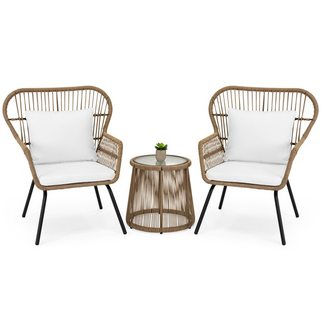 Develop a new fascination in your outdoor living space with this 3-piece bistro lounge set. Its inviting design is perfect for lounging with a friend over a refreshing beverage and tasty finger food. A sophisticated addition in any capacity, it includes a handwoven, see-through wicker design sure to compliment any porch, patio, or garden. Invite a friend over and put this furniture set at the center of discussion.