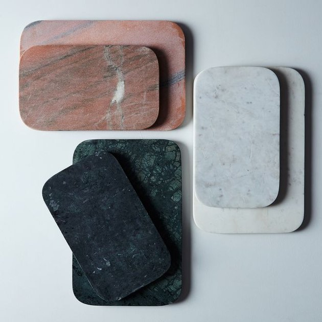 Your charcuterie spread will be the star of the party when you arrange it on this show-stopping marble and metal serving board from Hawkins New York. Grooves on the shorter edges make it an easy carry from kitchen to dining room—or in the case of some of our smaller apartments, from kitchen to… kitchen.