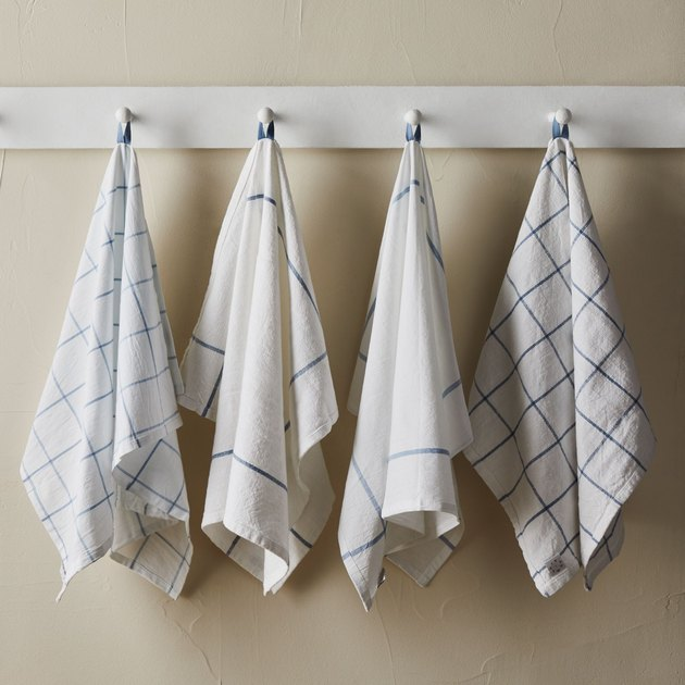 "Both towels are sized just-right in a 20""x 30"" dimension. They're also crafted in prewashed cotton, so they're the most absorbent, best-performing towels around. Each features a handy hanging loop — this is a feature on many a kitchen towel, sure, but we scooched ours 15"" over so it won't sag on your counters or floors. With a design inspired by classic French windowpane checks, all sets include two different but complementary patterns — which is oh-so-helpful if you'd like to give each towel a specific task. (Mop up spills with one, dry dishes with the other: Instantly streamline your life)."