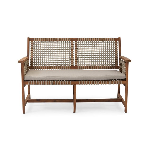 The Belham Living Raeburn Wood and Rope Outdoor Bench provides a spacious and welcoming outdoor seating option for the whole family. This charming bench has a rich oil finish on its exposed acacia wood frame, creating a natural warmth that contrasts with its rustic rope seat and back. The open rope weave gives an airy look to the supportive back and arms of the structure, while the beige seat cushion complements the neutral hues.