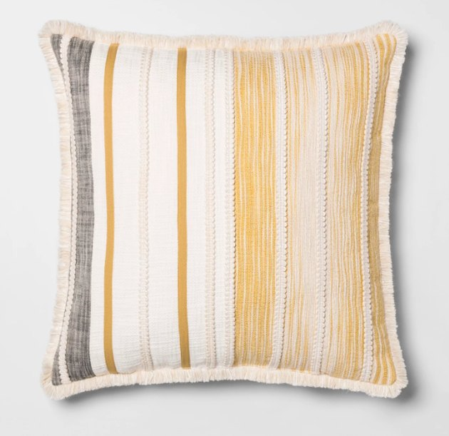 Bring classic elegance to your home decor with this Patched Oversize Throw Pillow from Opalhouse™. This decorative throw pillow features a simple patchwork design along with embroidered detailing and side fringes, adding a touch of timeless artistry that easily complements your existing decor. Designed with fabric fill and a 100% cotton exterior, this oversized throw pillow gives you a soft surface for reading, relaxing, watching TV and more. Whether you use it in your living room or your guest room, this decorative accent pillow brings color and whimsical flair to your home.