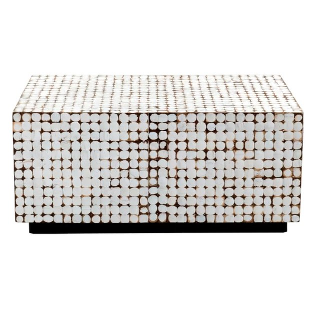 A centerpiece sure to make a statement in your seating ensemble, this coffee table brings rustic charm and a taste of today into one posh piece. Taking on a clean-lined, rectangular silhouette founded atop a smaller platform for modern appeal, its frame is crafted of solid teak wood and features a distressed geometric motif that's a little more weathered. Offers a rough feel and a sealant laminate for a touch of texture.