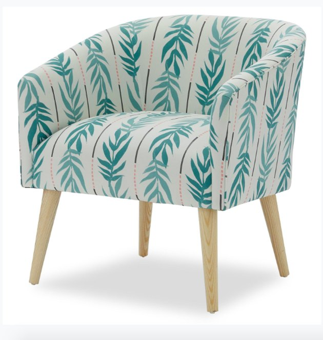 With a cushiony polyester fill and a smooth 55% cotton and 45% linen finish, it'll be love at first sit with this warm, cozy accent chair. Strong, tapered legs angle outward in a light, natural-looking wood finish for the cherry on top of this seat-sundae. Complete your home's vintage vibes with other items from Drew Barrymore Flower Home.