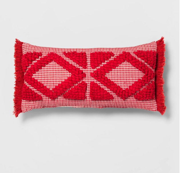 This decorative throw pillow features a tufted pattern that creates diamond and triangle accents on the front for dimension and texture. It also has short fringe on the short sides for a pop of fun style. With a bright color palette and a 100% cotton exterior for softness, this textured accent pillow can help you create eclectic style in any room.