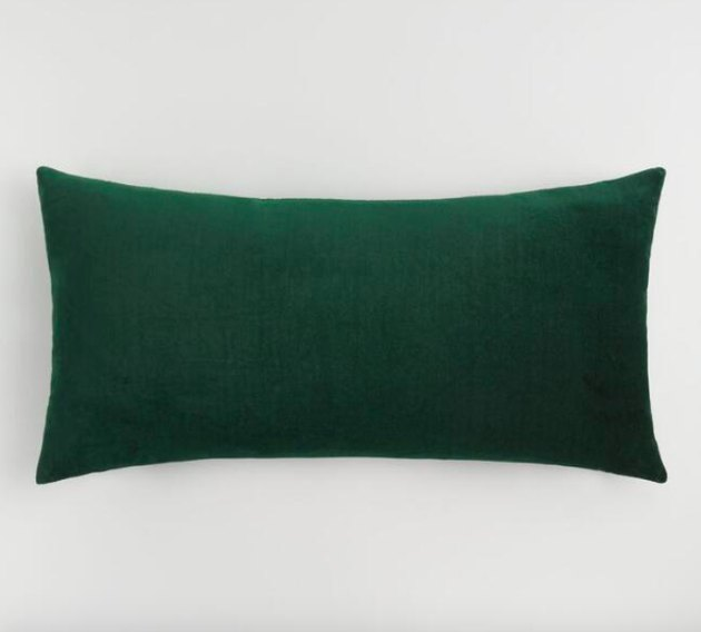 Crafted of luxurious cotton velvet, our forest green lumbar pillow is a plush update for any chair or sofa. Combine this exclusive pillow with other chic colors to refresh any room instantly.