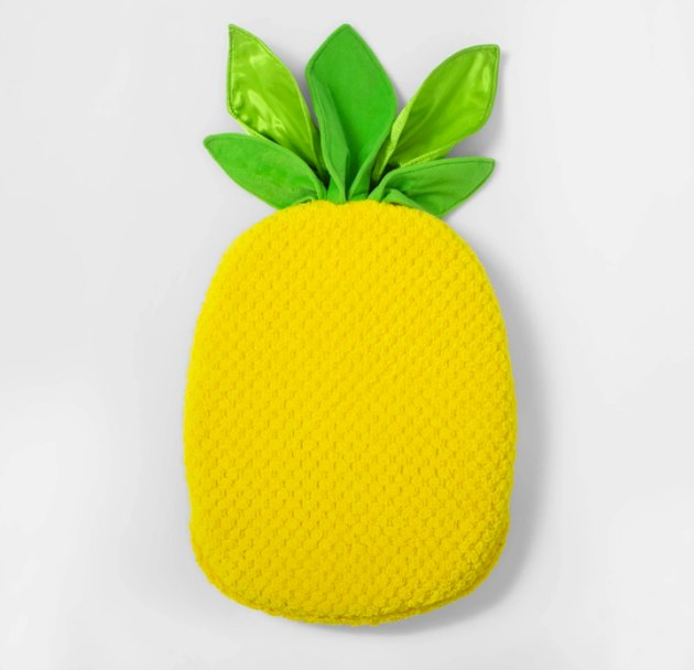 Refresh your kiddo's space by providing them with something to relax on, explore and cozy up to, like this Pineapple Sensory Floor Cushion from Pillowfort™. With a cheerful pineapple design in bright yellow and green, this sensory cushion for kids is sure to bring a sweet twist to any space your kid loves to call their own. They'll enjoy using it as a soft floor cushion when reading a book, playing a game or just hanging out, but they can also use it as comfy support when needed, thanks to its satin-velvet fabric and thick foam fill.