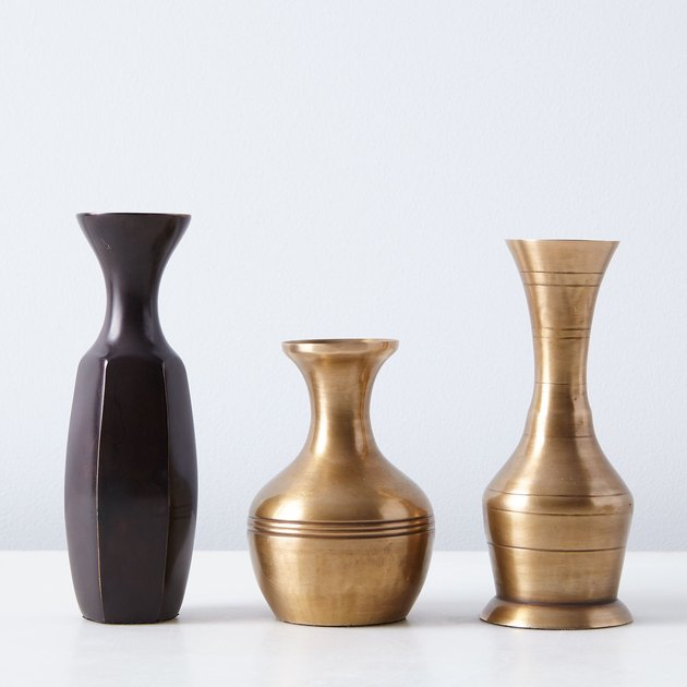 """These brass bud vases live and breathe the adage """"a little goes a long way"""". Drop just a few stems in one of these vintage-inspired charmers and boom, instant arrangement. They come in three different styles, all mixable and matchable."""