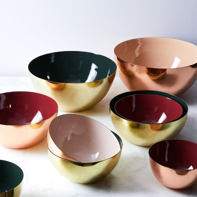 Giving the table—any table—a festive gleam has never been easier. The spun aluminum makes these lightweight bowls ideal for kitchen prep or serving, the interior enamel coating makes them food-safe, and copper or brass plating on the bowls' outside makes them look like holiday baubles. We're reaching for them in every size: Serve a salad in the extra large bowl, pile oranges into the large bowl and leave it on your breakfast table, set a medium-sized bowl of pinecones out on your coffee table, and let the smallest bowl be a catchall on your dresser or desktop.